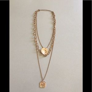 Three chains rose gold necklace